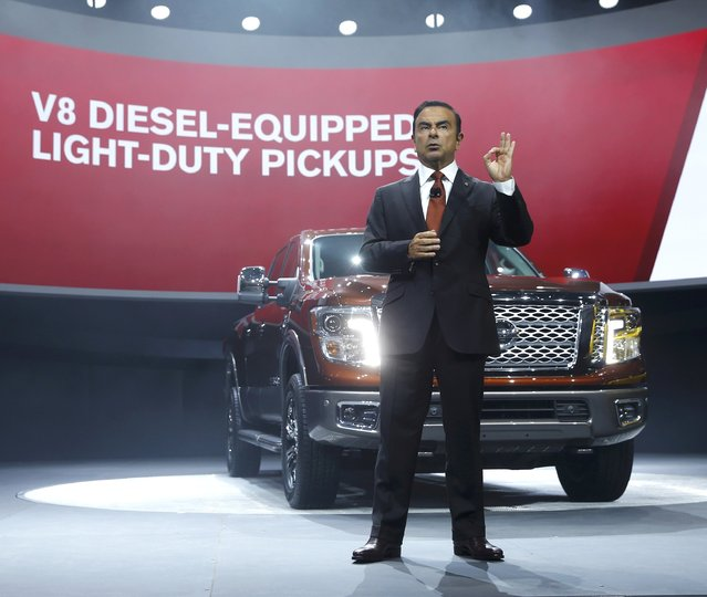 Nissan CEO Carlos Ghosn speaks next to the 2016 Nissan Titan pickup truck after it was unveiled at the first press preview day of the North American International Auto Show in Detroit, Michigan, January 12, 2015. (Photo by Mark Blinch/Reuters)