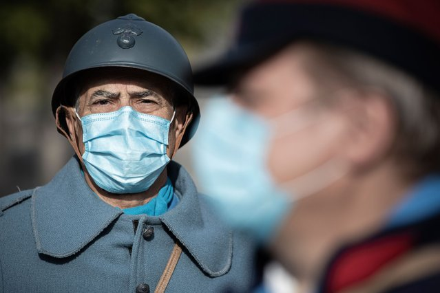 Re-enactors in World War One (WWI) French army uniform, wear protective nose and mouth masks against the novel coronavirus, Covid-19, as they participate in a two day event to mark the 106th anniversary of the Battle of the Marne which took place in September 1914 and which resulted in an Allied victory against the German armies in the west, in Meaux on September 5, 2020. (Photo by Joel Saget/AFP Photo)