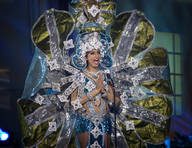 Miss Sir Lanka, Marianne Page, poses for the judges, during the national costume show during the 63rd annual Miss Universe Competition in Miami, Fla., Wednesday, January 21, 2015. (Photo by J. Pat Carter/AP Photo)