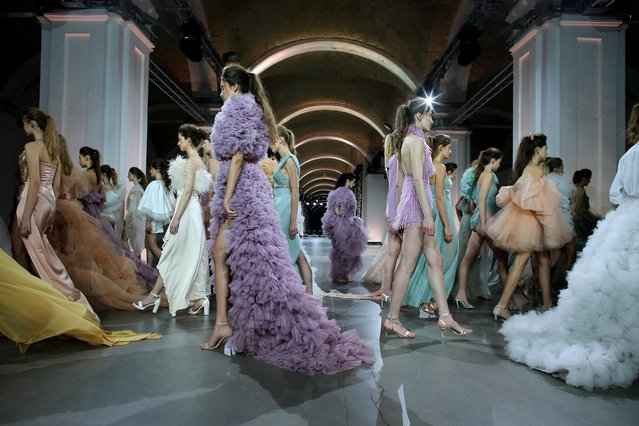 In this image released on February 5th – Models walk the runway at the Cihan Nacar show on February 04, 2021 in Kyiv, Ukraine. (Photo by Ferhat Zupcevic/Getty Images for Cihan Nacar)