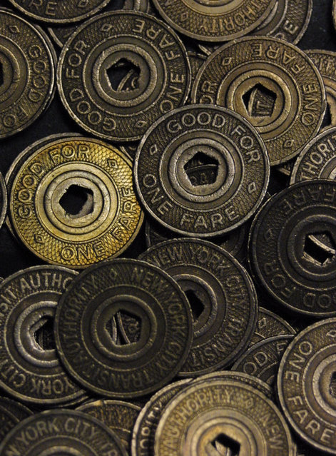 A pile of New York City subway tokens is shown, April 12, 2003 in New York. The city's subway token will no longer be accepted after May 4, its long career as the currency of city life ended by technology and fiscal problems. (Photo by Tina Fineberg/AP Photo)