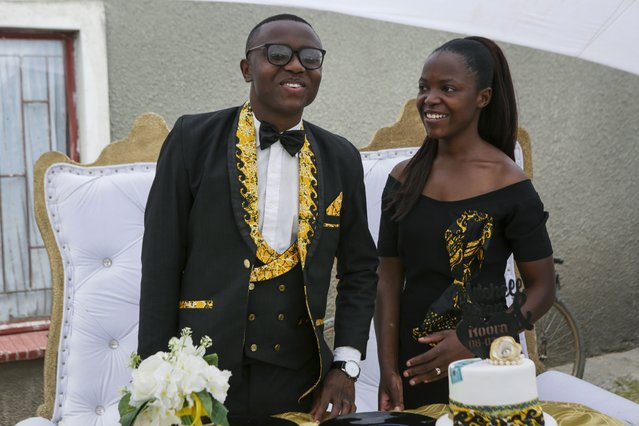 Brian Ngona, left, and Mitchelle Musaraure, pose for a photo after their traditional marriage ceremony in the capital Harare, Zimbabwe Saturday, March 6, 2021. (Photo by Tsvangirayi Mukwazhi/AP Photo)