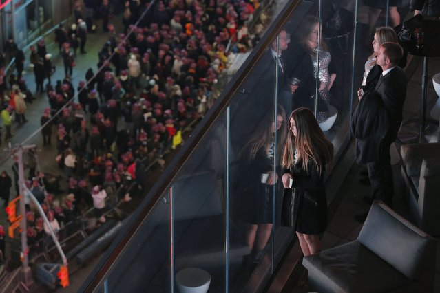 Revelers look at the gathered crowds as they wait for the start of New Year's festivities inside  Times Square in New York December 31, 2015. (Photo by Lucas Jackson/Reuters)