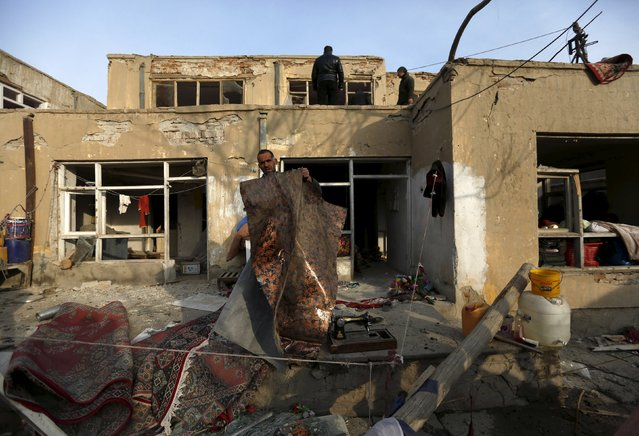 """An Afghan man removes broken glass from his home after a suicide attack on French restaurant  """"Le Jardin"""" in Kabul, Afghanistan January 2, 2016. (Photo by Mohammad Ismail/Reuters)"""