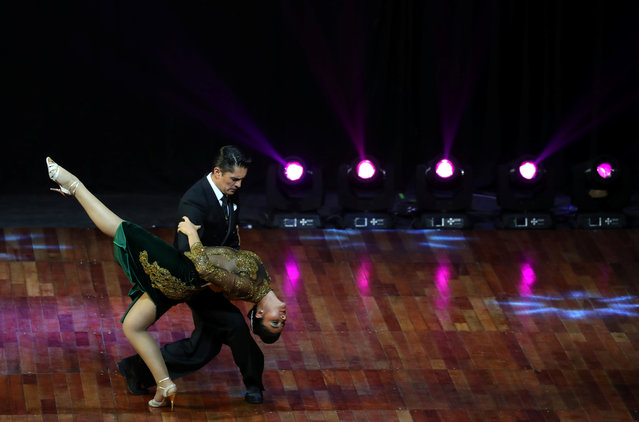 Edwin Espinosa and Alexa Yepes Arboleda, representing the city of Medellin, Colombia, dance during the Stage style final round at the Tango World Championship in Buenos Aires, Argentina on August 23, 2018. (Photo by Marcos Brindicci/Reuters)