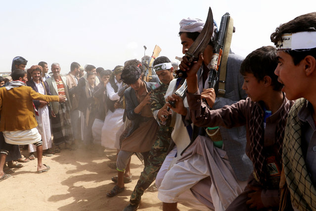 Followers of the Shi'ite Houthi movement perform the traditional Baraa dance as they take part in a ceremony marking the al-Ghadeer day in Saada, Yemen on August 29, 2018. The celebration marks a day Shi'ites believe Prophet Muhammad nominated his cousin, Imam Ali, to be his successor. (Photo by Naif Rahma/Reuters)