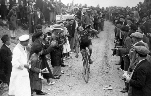 Frenchman Georges Speicher drinks as he starts riding down the Col de l'Aubisque during the 18th stage of the Tour de France between Tarbes and Pau. on July 17, 1933. Speicher finished second beaten by Spanish winner Learco Guerra to retain his overall leader's yellox jersey on his way to winning the Tour de France. (Photo by France Presse Voir/AFP Photo)