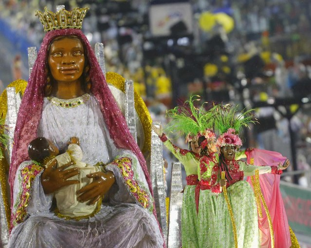 Revellers from the Mangueira samba school participate in the annual carnival parade in Rio de Janeiro's Sambadrome, February 15, 2015. (Photo by Ricardo Moraes/Reuters)