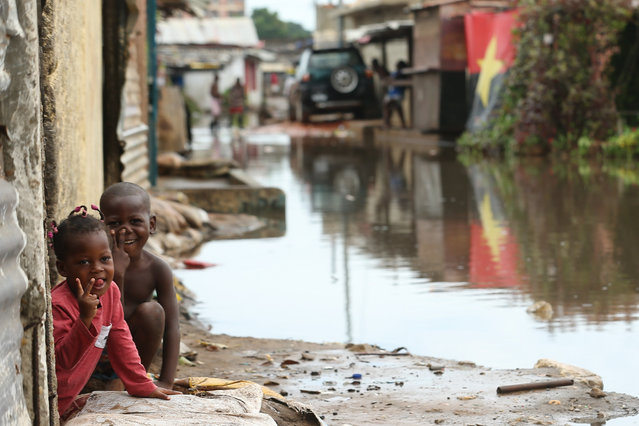 Flooded street in the Sambizanga neighborhood following the heavy rains that fell on 19 April that caused the death of 14 people and flooded more than 16,000 houses, Luanda, Angola, 20 April 2021. (Photo by Ampe Rogerio/EPA/EFE)