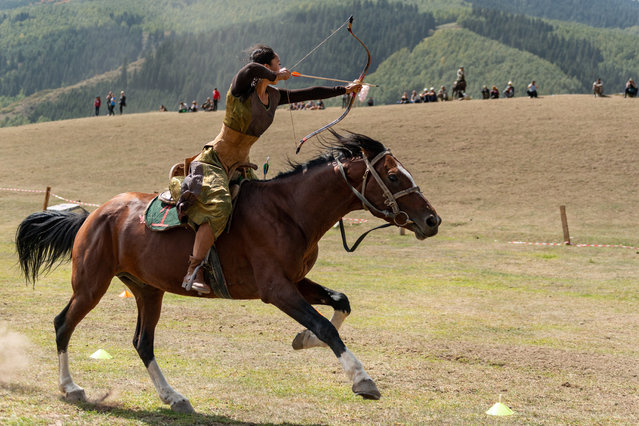 Aida Akhmatova from Kyrgyzstan fires at three targets along a 120-metre track before placing second for the women's division of mounted archery. To make the competition fair, none of the athletes are familiar or accustomed to their horse, and the women must alternate the horses among them. Not only are they up against the challenge of hitting their targets, but also controlling their horse. (Photo by Eleanor Moseman/The Guardian)