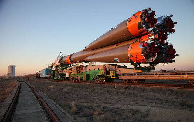 Russian Soyuz-FG rocket with Soyuz TMA-10M  spacecraft aboard is transported to a launch pad at the Russian-leased Baikonur cosmodrome in Kazakhstan, on September 23, 2013. Soyuz TMA-10M is a planned transport the Expedition 37 crew, including Michael Hopkins of the US together with Russia's Oleg Kotov and Sergei Ryazansky, to the International Space Station (ISS) on September 26. (Photo by AFP Photo/STR)