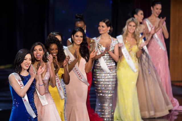Contestants applaud during the Grand Final of the Miss World 2016 pageant at the MGM National Harbor December 18, 2016 in Oxon Hill, Maryland. (Photo by Zach Gibson/AFP Photo)