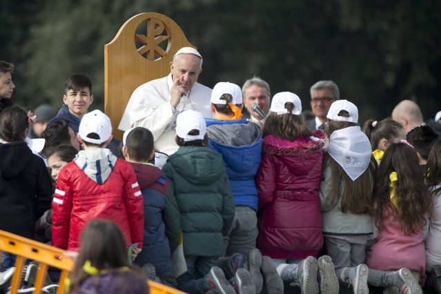 Pope Francis meets residents of Scampia, suburb of Naples, Italy, Saturday, March 21, 2015. Francis is on a one-day visit to Naples and Pompeii. (Photo by Andrew Medichini/AP Photo)