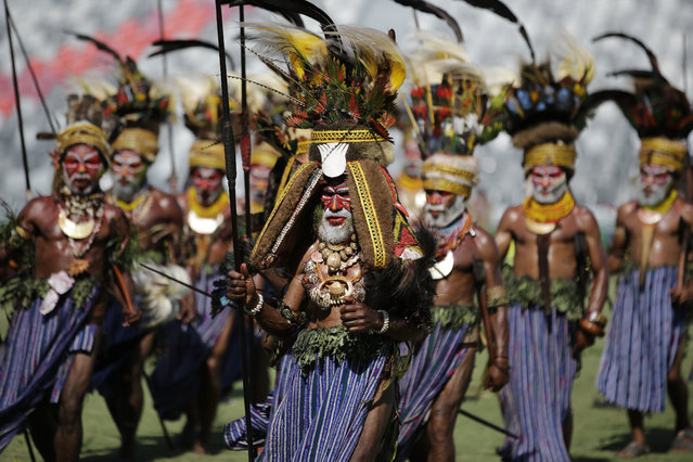 Dancers wearing traditional costumes perform during a cultural show as part of APEC 2018 activities at Port Moresby, Papua New Guinea on Friday, November 16, 2018. (Photo by Aaron Favila/AP Photo)