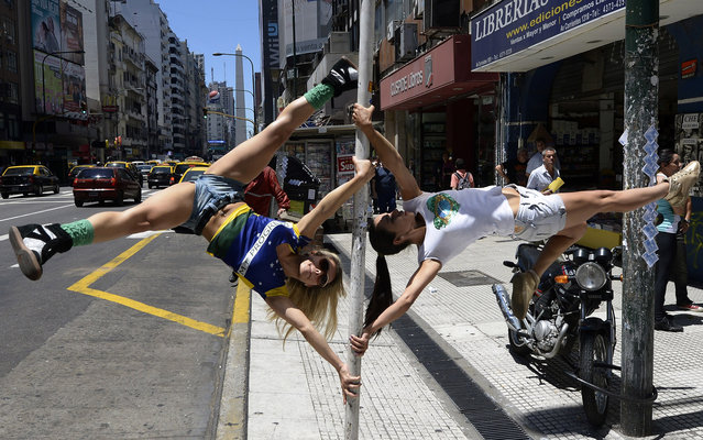 Participants in the Miss Pole Dance South America 2013 competition perform in downtown Buenos Aires on November 22, 2013 ahead of the contest to be held on November 23 and 25 in the city. (Photo by Juan Mabromata/AFP Photo)