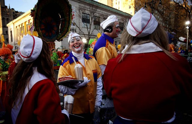 Clowns prepare before the parade. (Photo by Carlo Allegri/Reuters)