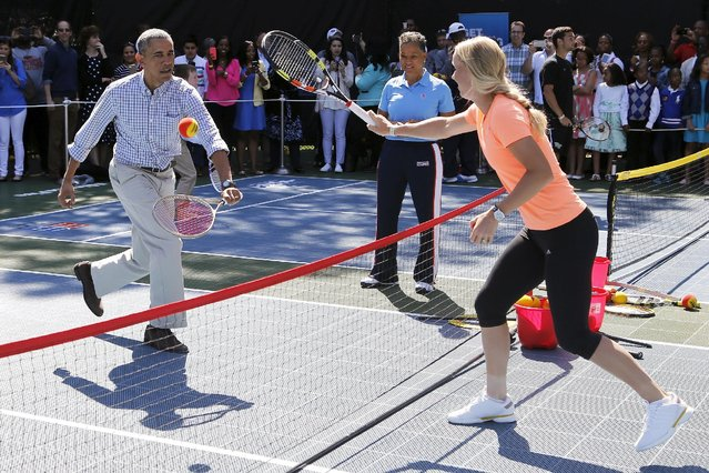 U.S. President Barack Obama plays tennis with tennis player Caroline Wozniacki, one of the activities at the annual Easter Egg Roll at the White House in Washington April 6, 2015. (Photo by Jonathan Ernst/Reuters)