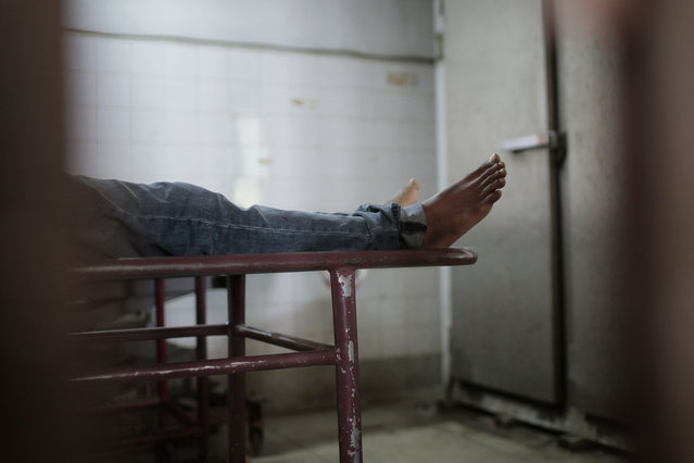 This Monday, March 30, 2015 photo shows the body of the late Bangladeshi blogger Washiqur Rahman Babu in a morgue at the Dhaka Medical College in Dhaka, Bangladesh. The blogger, 26, was hacked to death by three men in Bangladesh's capital on Monday, police said. The killing took place a month after a prominent Bangladeshi-American blogger known for speaking out against religious extremism was hacked to death in Dhaka. (Photo by A. M. Ahad/AP Photo)