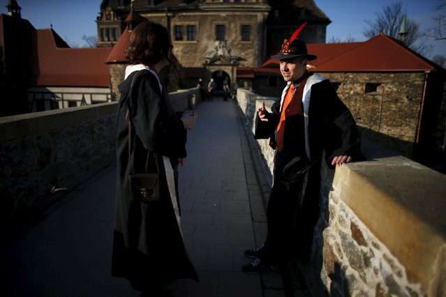 Participants talk in front of the castle before the role play event at Czocha Castle in Sucha, west southern Poland April 9, 2015. (Photo by Kacper Pempel/Reuters)