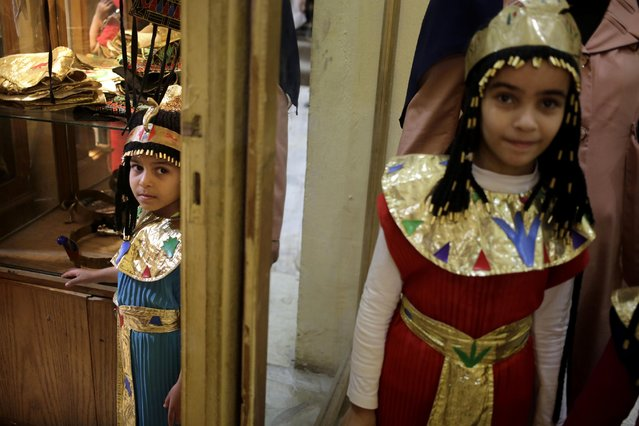 "Egyptian children wearing Pharaonic costumes prepare to take a photo at the souvenir studio of the Pharaonic Village, during Sham el-Nessim, or ""smelling the breeze"", in Giza, Egypt, Monday, April 13, 2015. (Photo by Amr Nabil/AP Photo)"