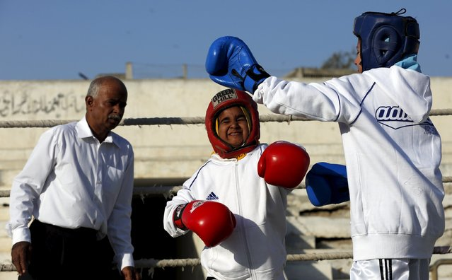 Tabia (R), 12, fights against Aamna, 11, during the Sindh Junior Sports Association Boxing Tournament in Karachi, Pakistan February 21, 2016. For the past six months about a dozen girls, aged 8 to 17, have gone to the Pak Shine Boxing Club after school to practice their jabs, hooks and upper cuts. Pakistani women have been training as boxers in small numbers and competed in the South Asian Games last year, said Younis Qambrani, the coach who founded the club in 1992 in the Karachi neighbourhood of Lyari, better known for internecine gang warfare than for breaking glass ceilings. (Photo by Akhtar Soomro/Reuters)