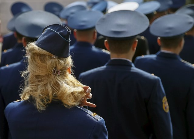 Ukrainian Air Force officers attend a graduation ceremony at the National University of Defence of Ukraine in Kiev, April 24, 2015. (Photo by Gleb Garanich/Reuters)