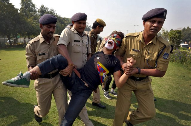 Indian police detain a Tibetan activist during a protest held to mark the 57th anniversary of the Tibetan uprising against Chinese rule, outside the Chinese embassy in New Delhi, India, March 10, 2016. (Photo by Cathal McNaughton/Reuters)