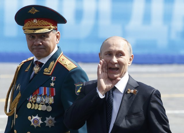 Russia's President Vladimir Putin (R) greets veterans next to Defence Minister Sergei Shoigu after the Victory Day parade at Red Square in Moscow, Russia, May 9, 2015. (Photo by Grigory Dukor/Reuters)