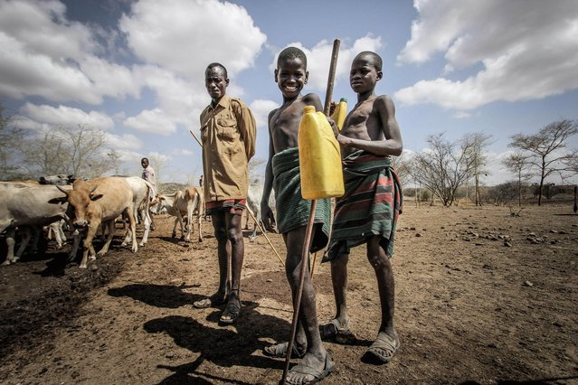 Karamojong boys begin looking after goats when they're five years old. At the age of around seven, they will move on to calves and by the age of ten they will be looking after cows, Karamoja, Uganda, February, 2017. (Photo by Sumy Sadurni/Barcroft Images)