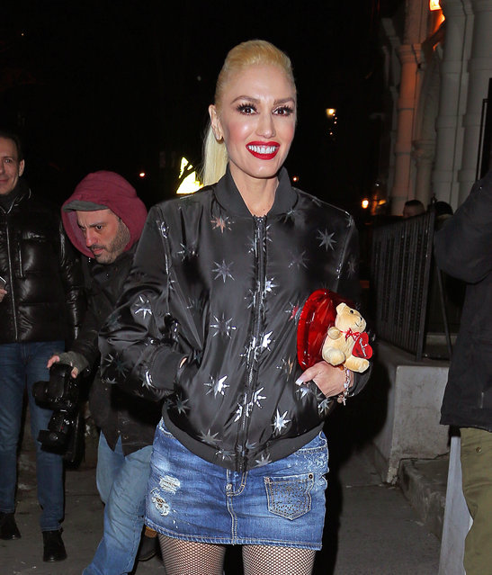 Gwen Stefani spotted leaving a restaurant where she was celebrating with her hairstylist Danilo Dixon for his birthday in New York City, New York, USA on February 14, 2017. When Gwen leaves the restaurant a fan gives her a box of chocolates with a teddy bear for Valentine's Day, he also gives Danilo a pack of donuts for his birthday and you can see Gwen taking a picture with the fan. (Photo by Andrew Rocke/Splash News)