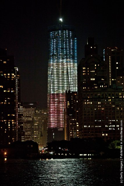 One World Trade, lit red, white and blue, is seen at night on September 9, 2011 in New York City