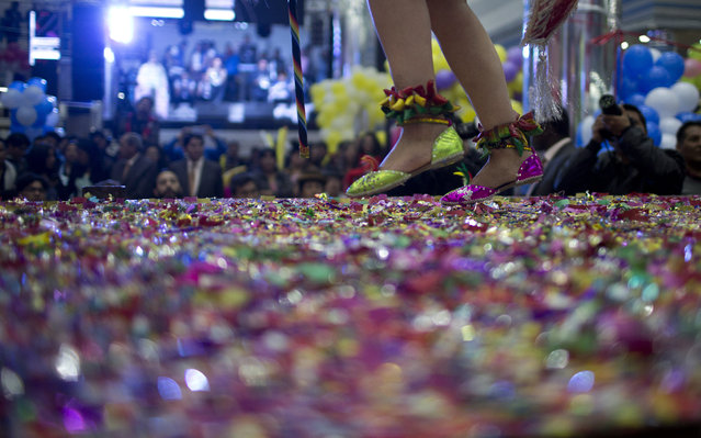 A contestant competes on stage blanketed in confetti in the Queen of Great Power contest, in La Paz, Bolivia, Friday, May 24, 2019. (Photo by Juan Karita/AP Photo)