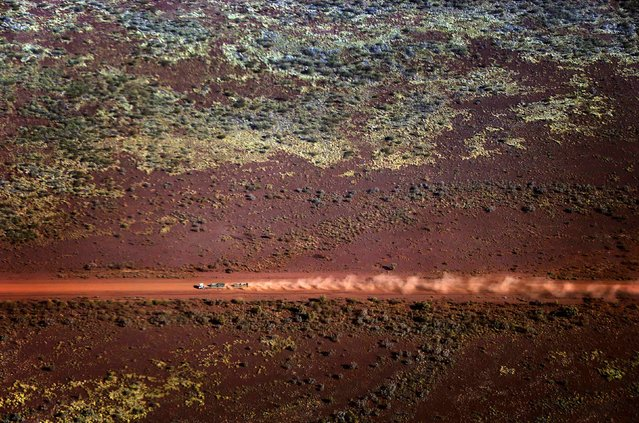 A truck drives along a dirt road in the Pilbara region of Western Australia December 3, 2013. (Photo by David Gray/Reuters)