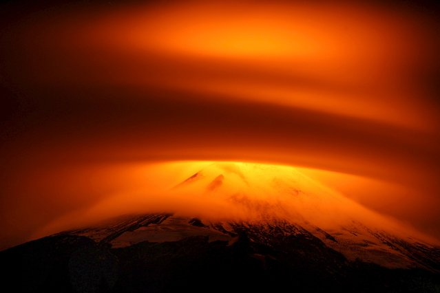 The Villarrica Volcano is seen partially covered by clouds at Pucon, Chile, May 18, 2015. Picture taken May 18, 2015. (Photo by Cristobal Saavedra/Reuters)