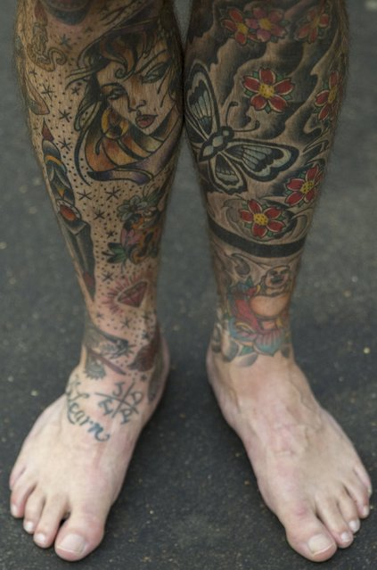 A man poses to display his leg tattoos during the Great British Tattoo Show in Alexandra Palace in north London, Britain May 23, 2015. (Photo by Neil Hall/Reuters)