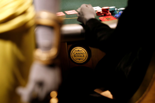 """A gaming table with the film """"Casino Royale"""" title design is seen at the exhibition """"The Designing 007: Fifty Years of Bond Style"""" during a press presentation at the Grande Halle de la Villette in Paris, France, April 13, 2016. (Photo by Benoit Tessier/Reuters)"""