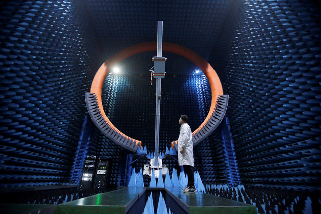 An engineer stands under a base station antenna of 5G in Huawei's SG178 multi-probe spherical near-field testing system at its Songshan Lake Manufacturing Center in Dongguan, Guangdong province, China on May 30, 2019. (Photo by Jason Lee/Reuters)