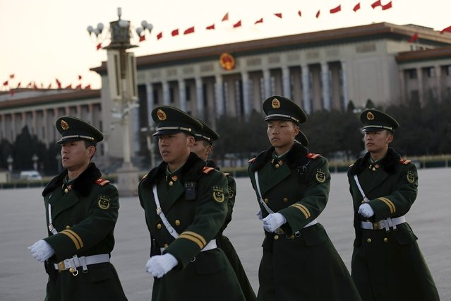 Paramilitary police officers arrive for a national flag lowering ceremony at Tiananmen Square on March 6, 2017 in Beijing, China. The fifth session of the 12th National People 's Congress will be opened on March 5, March 15 morning officially closed. (Photo by Lintao Zhang/Getty Images)