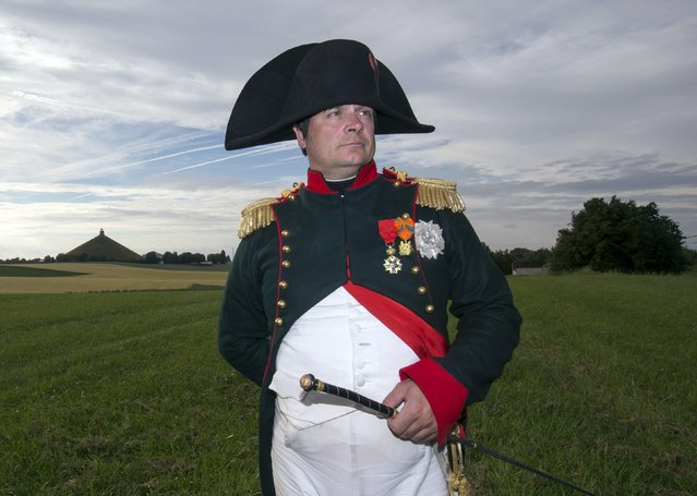 Frenchman Frank Samson who is taking part in an re-enactment of the Battle of Waterloo poses in front of the  Lion's Mound of Waterloo during the bicentennial celebrations for the Battle of Waterloo, in Waterloo, Belgium June 17, 2015. The commemorations for the 200th anniversary of the Battle of Waterloo will take place in Belgium on June 19 and 20.   REUTERS/Yves Herman REUTERS/Yves Herman