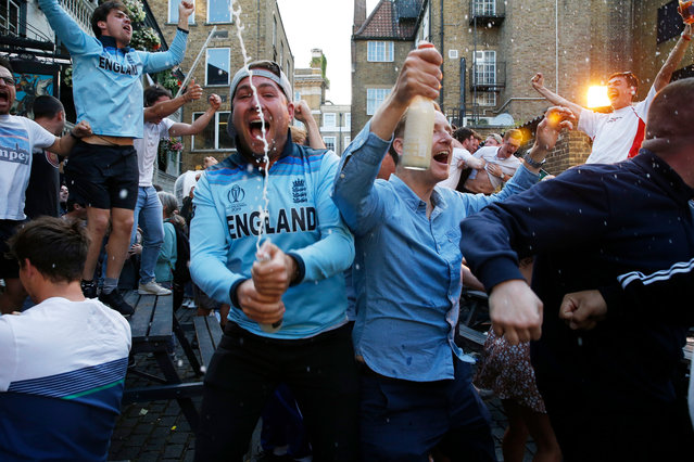 English cricket fans celebrate England's victory over New Zealand at The George Inn, in London, Britain, 14 July 2019, after watching the 2019 Cricket World Cup final between England and New Zealand at Lords cricket ground. (Photo by Hollie Adams/EPA/EFE)