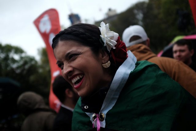 Karina Garcia from Elmhurst, Queens, wears a Mexican flag as she takes part in a May Day International Workers Day Rally for Workers and Migrants in Union Square in Manhattan, New York, U.S., May 1, 2016. (Photo by Mike Segar/Reuters)