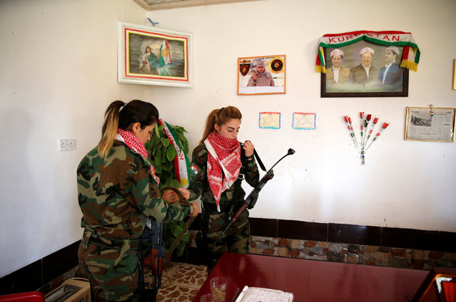 Female Peshmerga fighters hold their weapons at a site near the frontline of the fight against Islamic State militants in Nawaran near Mosul, Iraq, April 20, 2016. (Photo by Ahmed Jadallah/Reuters)