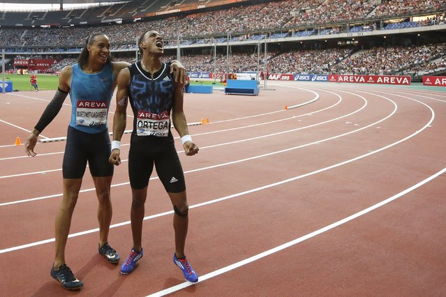 Orlando Ortega (R) of Cuba reacts next to Pascal Martinot-Lagarde of France after winning the men's 110m hurdles event at the IAAF Diamond League athletics meeting at the Stade de France Stadium in Saint-Denis, near Paris, France, July 4, 2015. (Photo by Stephane Mahe/Reuters)