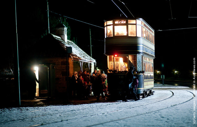 Visitors queue to board a tram at Beamish, the living museum of the North, on December in Birtley, Tyne and Wear
