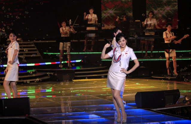 In this Friday, March 28, 2014 photo, singers of the Moranbong Band, Jong Su Hyang, foreground, and  Pak Mi Kyong, left perform on their stage in Pyongyang, North Korea. Step aside, Sea of Blood Opera. North Korean leader Kim Jong Un's favorite guitar-slinging, miniskirt-sporting girl group, the Moranbong Band, is back. And these ladies know how to shimmy. (Photo by Jon Chol Jin/AP Photo)