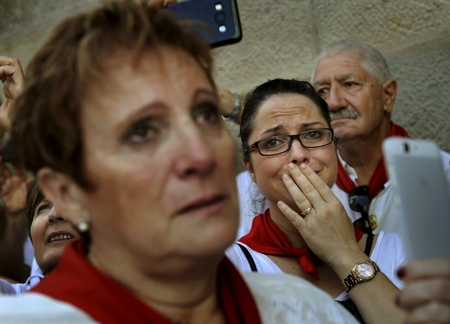 "A woman cries during a procession in honour of San Fermin on the saint's day at the San Fermin festival in Pamplona, northern Spain, July 7, 2015. A statue dating from the 15th century is paraded through the streets of the town in honour of the patron saint of Navarra and first bishop of Pamplona, and ""Jotas"" are sung and played in his honour. (Photo by Eloy Alonso/Reuters)"