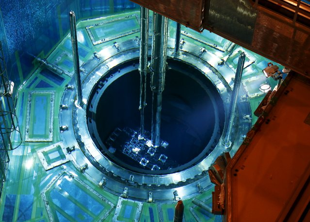 A fuel rod is inserted into a reactor vessel inside the No. 1 reactor building at Kyushu Electric Power's Sendai nuclear power station in Satsumasendai, Kagoshima prefecture, Japan, July 8, 2015. (Photo by Issei Kato/Reuters)