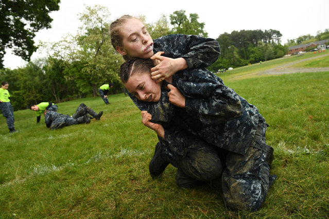 United States Naval Academy plebes, Monika Gyalay, bottom center, and Shelby Sipes, top center, take part in ground fighting during Sea Trials at the United States Naval Academy on Tuesday May 17, 2016 in Annapolis, MD. (Photo by Matt McClain/The Washington Post)