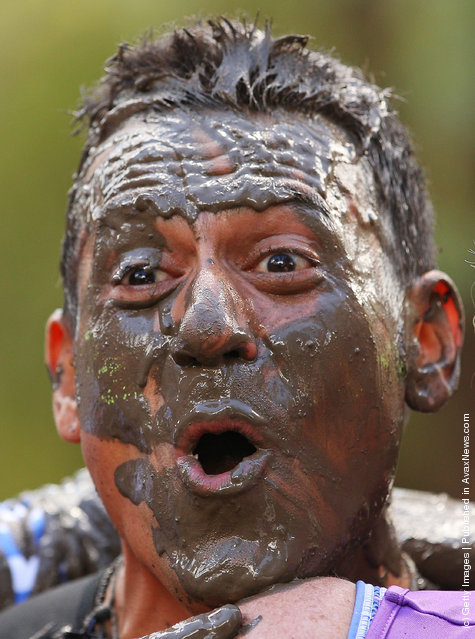 Sebastian Torallo reacts after crawling through the mud pit as he competes in The Tough Bloke Challenge