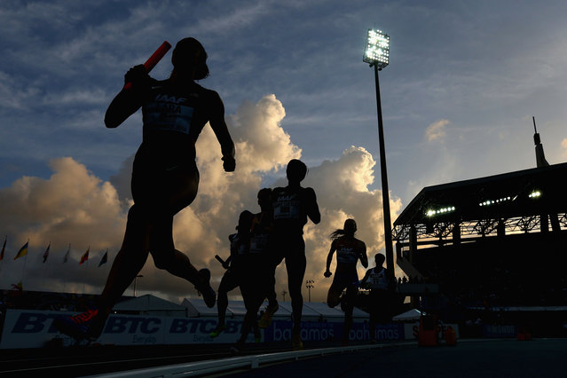 Geena Lara (left) of the United States competes in the Women's 4x800 meter relay final during day two of the IAAF World Relays at the Thomas Robinson Stadium on May 25, 2014 in Nassau, Bahamas. (Christian Petersen/Getty Images for IAAF)